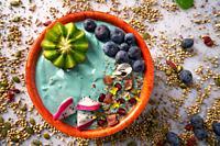 Acai bowl smoothie with kiwi blueberry seeds and pitaya dragon fruit.