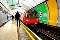 London, England, UK. Tube train arriving in Bond Street underground station.