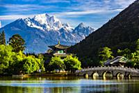 The idyllic Black Dragon Pool with the Deyue Pavilion at the center and the 18,360 foot Jade Dragon Snow Mountain behind, Lijiang, Yunnan Province, Ch...