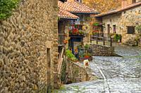Typical stone house with flowers. Rural Village of Barcena Mayor Los Tojos. Saja Natural Park, Saja-Nansa, Cantabria, Spain Europe.
