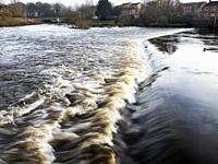 The River Ure in Spate at the Weir in Boroughbridge North Yorkshire England.