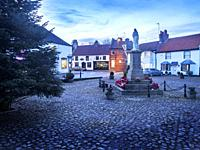 War Memorial in Hall Square at Dusk in Boroughbridge North Yorkshire England.