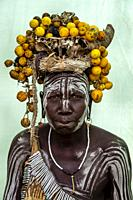 A Portrait Of A Woman From The Mursi Tribe, Mursi Village, Omo Valley, Ethiopia.