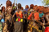 Young Hamar Women Dancing At A Bull Jumping Ceremony, Dimeka, Omo Valley, Ethiopia.