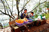 child selling fruits, Yunnan, China