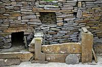 Skara Brae Stone Age Neolithic village at Skaill, Orkney, Scotland. Interior detail of stone box bed and alcoves in House 1. 3100 BC.