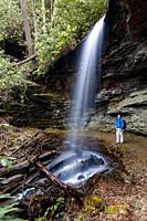 Hiker at Little Moore Cove Falls - Pisgah National Forest, Brevard, North Carolina, USA.
