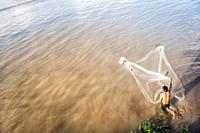 Young vietnamese fishing in Mekong river, Chau Doc (An Giang Province, Vietnam).