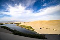 Desert of Ica in Peru, sand dunes and lagoon, South America.