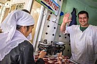 Uzbekistan, surroundings of Bukhara, local market, butcher.