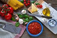 Italian Spaghetti pasta food with cheese tomato garlic basil on wood.