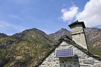 A solar panel installed on a rustic building. Maggia. Vallemaggia District. Ticino. Swizterland.