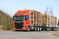 Orange Next Generation Scania R650 logging truck on test drive on a clear day of spring on Scania Tour Turku 2018. Lieto, Finland - April 12, 2018.