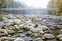 Suspension foot bridge, which crosses the Peabody River at the start of the Great Gulf Trail in Green's Grant of the New Hampshire White Mountains on ...