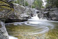 Upper Ammonoosuc Falls, which are located along the Ammonoosuc River in Crawford's Purchase of the New Hampshire White Mountains during the spring mon...