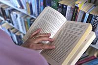 Choosing a book in Library,UK.