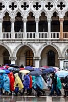 Tourists In St Markâ. . s Square In The Rain, Venice, Italy.