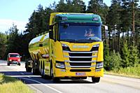 Colorful Next Generation Scania R580 V8 tank truck of K Pekki Oy moves along rural highway in summer to pick up a load. Salo, Finland - July 1, 2018.