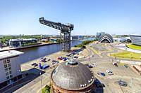 View west along the River Clyde with the Anderston crane, the Armadillo concert venue, part of the Scottish Exhibition and Conference Centre and STV S...
