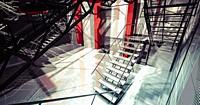 Nobody. Modern industrial interior, stairs, clean space in industry building.