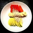 Papaya, banana and apple covered with amaranth for breakfast in a restaurant in Coyoacan, Mexico