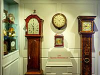 Longcase and other antique clocks on display at the premises of Carter Marsh and Co. in Winchester, England (Permission to photograph kindly given by ...