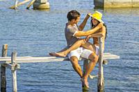 Young couple Summer vacation and Yellow hat.