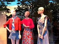 Three mannequins in a shop window. Madrid, Spain.