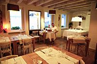 Inside the Trattoria Antica Maddalena restaurant on Via Pelliccerie in Udine, Italy.