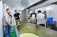 Tour guide with group, Preparation of sheep's cheese, Cheese denomination of origin Idiazabal, Caserio Mausitxa, Elgoibar, Gipuzkoa, Basque Country, S...