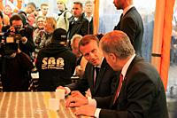 Helsinki, Finland. August 30, 2018. French President Emmanuel Macron (C) and Finnish President Sauli Niinistö (R) have a cup of coffee at Market Squar...