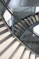 Knife edge stair revolutions in glass and chrome spiralling downwards at the Roman Museum, Nimes, Provence, France.