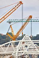 Giant cranes supporting metal structure, Truss Placement, Anoeta Stadium Cover, Amara, Donostia, San Sebastian, Gipuzkoa, Basque Country, Spain