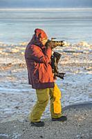 Photographer Lynn Hackett along the Hudson Bay coast, Churchill, Manitoba, Canada.