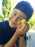 Boy with duckling.