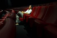 Woman Sitting Alone in Movie Theater.