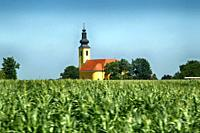 Onion domed church in the middle of a farmer's field seen in Hungary.