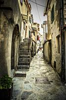 The narrow winding streets and staircases in the medieval village of Vrbnik on the Croatian island of Krk.