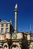 Mercat Cross with Royal Unicorn in Old Town of Edinburgh in Parliament Square on Royal Mile Scotland United Kingdom.