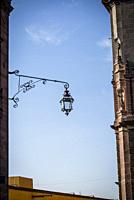 Street lantern agains blue sky, San Miguel de Allende, Bajío region, Central Mexico.