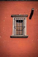 San Miguel de Allende, Barred window on a facade in a colonial-era city, Bajío region, Central Mexico.