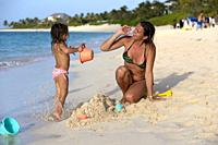 Playing in the beach, Cabbage Beach, New Providence Island, Paradise Island, Bahamas.