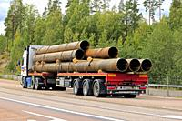 Orivesi, Finland - August 27, 2018: Volvo FH12 semi trailer of Seikkala Logistics Oy transports metallic pipes along highway 4 in early autumn, rear v...