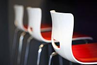 Contemporary styled modern chairs arranged in a row.