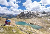 The hiker admiring the view of Bei Laghetti in Sobretta Valley, Santa Caterina Valfurva, Province of Sondrio, Valtellina, Lombardy, Italy, Europe.