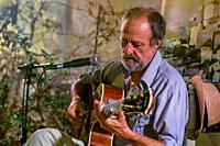 Blues guitarist and singer performs, Salobreña, Spain.
