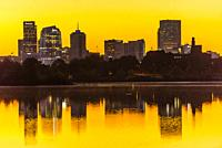 Sunrise at Sloans Lake with Downtown Denver in background, Colorado USA.. Sloan's Lake is the biggest lake in Denver, and at 177 acres, it' s the city...