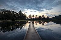 Straus Lake reflections at sunset - Brevard, North Carolina, USA.