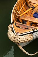 Decorative rope protection on the bow of a wooden dinhy.