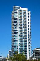Canada, Alberta, Calgary. A luxury highrise apartment tower in the downtown district.